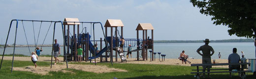 A playground on the beach with children playing